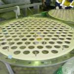 Tube plates coated