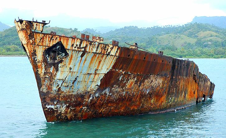Ship corroding away in ocean.