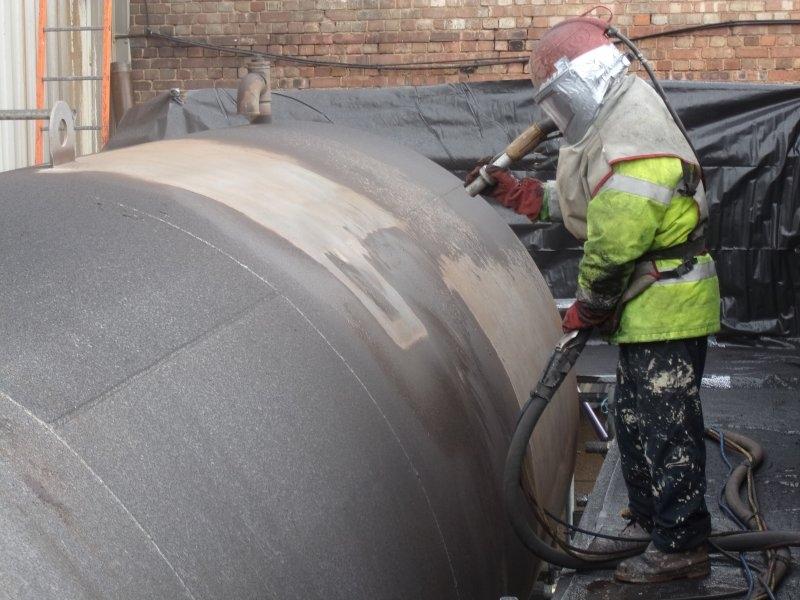 Abrasive blasting chemical tank