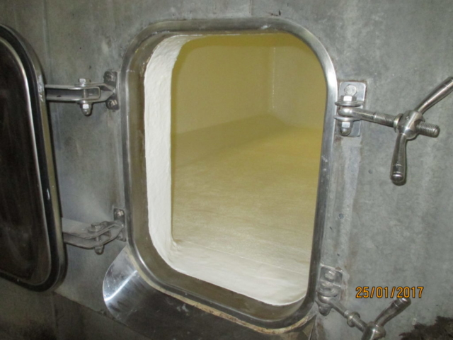 Concrete wine storage tank coated with Chemco epo-chem RB 500