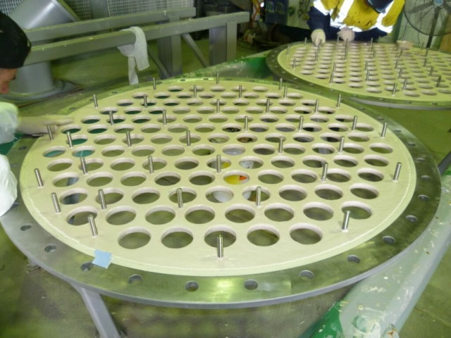 Coating of tube plates